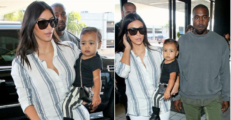 Filha de Kim Kardashian e Kanye West usa bolsa de R$ 3 mil da grife Saint Laurent